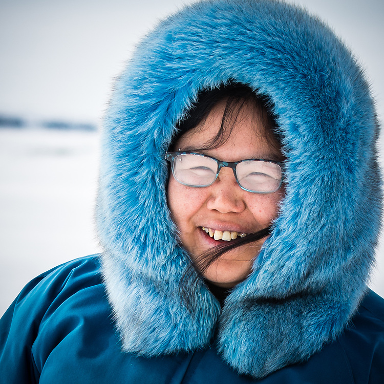 Stella Inukpuk, from Inukjuak,  with her own homemade parka. She is also an artist creating beautiful necklace.