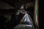 Brazilian pilgrim Victor Bezerra, 25, pitches his tent in an abandoned historical building during his four months journey on foot from Rome in Italy following the Way of St. James, or El Camino de Santiago, a network of ancient pilgrim routes stretching across Europe and converging at the tomb of St. James (Santiago in Spanish) in Santiago de Campostela in northwest Spain, on November 24, 2020 in Melide, Galicia, Spain. The Camino de Santiago is being affected by Covid-19 with strict restrictions regarding services and mobility along the routes. Starting October 30, 2020, Spanish authorities closed among others, the  perimeter of Santiago de Compostela. Only pilgrims that have been journeying before October 30 can stop at the cathedral of Santiago de Campostela, but they are not allowed to stay overnight and have to transit through.