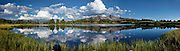 Reflections of a perfect summer day on Little Molas Lake in the Colorado Rockies, CO