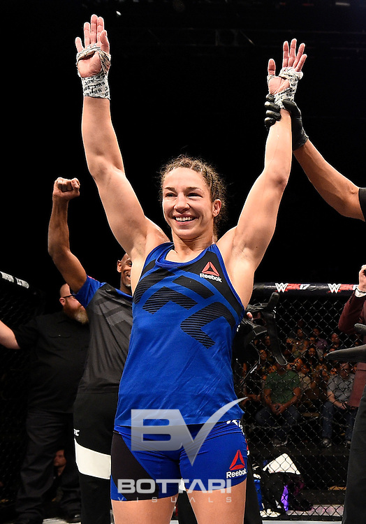 LAS VEGAS, NV - DECEMBER 03:  Sara McMann celebrates after her submission victory over Alexis Davis of Canada during The Ultimate Fighter Finale event inside the Pearl concert theater at the Palms Resort & Casino on December 3, 2016 in Las Vegas, Nevada. (Photo by Jeff Bottari/Zuffa LLC/Zuffa LLC via Getty Images)