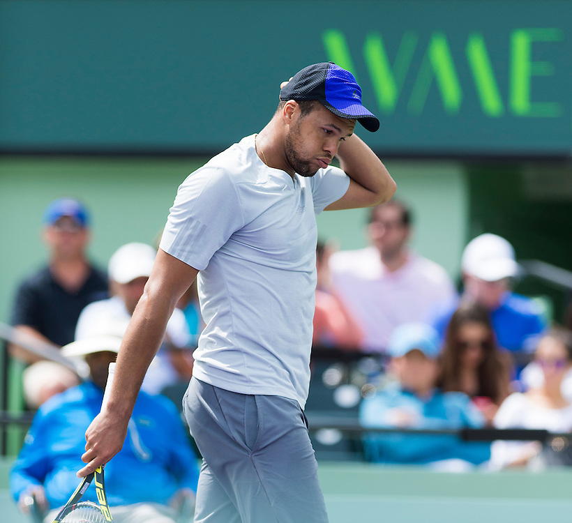 KEY BISCAYNE, FL - March 28: Jo-Wilfried Tsonga (FRA) makes a funny face after missing an overhead. Tsonga would go on to defeat Tim Smyczek (USA) 64 36 63 at the 2015 Miami Open in Crandon Park Tennis Center.  Photographer Andrew Patron - CameraSport/BigShots<br /> <br /> Tennis - 2015 Miami Open presented by Itau - Crandon Park Tennis Center - Key Biscayne, Florida - USA - Day 6, Saturday 28th March 2015<br /> <br /> © CameraSport - 43 Linden Ave. Countesthorpe. Leicester. England. LE8 5PG - Tel: +44 (0) 116 277 4147 - admin@camerasport.com - www.camerasport.com
