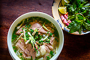 Vietnamese bowl of Pho with beef and vegetables. RAW to Jpg.