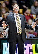 SHOT 2/14/13 8:08:29 PM - Colorado head basketball coach Tad Boyle works the sidelines against Arizona during their regular season Pac-12 basketball game at the Coors Event Center on the Colorado campus in Boulder, Co. Colorado won the game 71-58. (Photo by Marc Piscotty / © 2013)