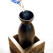 Sake Poor at Japanese Restaurant on white background