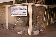 An advert for desert excursions in the village of Bairat on the West Bank of Luxor, Nile Valley, Egypt.