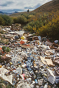 Garbage dumped in a rural area, Montana, USA