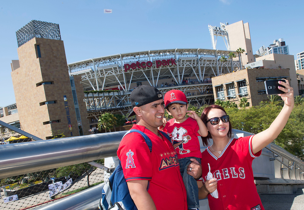 Jose and Mireya Gonzalez, of Santa Ana, stop for a photo next to Petco Park with their son Sebastian, 2, before the 2016 MLB All-Star Game in San Diego on Tuesday.<br /> <br /> <br /> ///ADDITIONAL INFO:   <br /> <br /> allstar.0713.kjs  ---  Photo by KEVIN SULLIVAN / Orange County Register  -- 7/12/16<br /> <br /> The 2016 MLB All-Star Game at Petco Park in San Diego.