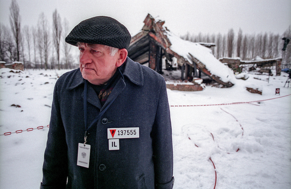 Dionizy Lechowicza, a Polish survivor of the Auschwitz Nazi concentration camp, attending the ceremony to mark the 60th anniversary of its liberation on the 27th of January 2005.  In the background are the ruins of the former crematorium. Lechowicz was born on 02.01.1917 and prisoned in Auschwitz Birkenau. He is holding a prisoners list with his name on it dated with the 5th of Ocober 1943. It is estimated that between 1.1 and 1.5 million Jews, Poles, Roma and others were killed here in the Holocaust between 1940-1945.