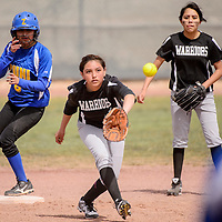 Zuni Thunderbird Alanee Esalio (6) tags up on second as Navajo Pine Warrior Maraih Yazzie (3) steps off the base to make the catch Friday at Tohatchi High School.