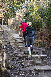 Couple doing training on stairs in nature