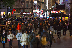 © Licensed to London News Pictures. 28/05/2021. London, UK. Revellers make the most of Friday night out in Leicester Square, central London ahead of bank holiday.  Photo credit: Marcin Nowak/LNP
