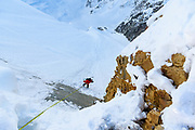 Split boarder Joey Vosburgh dropping into the shelf life, Rogers Pass, BC