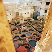 Large vats of dye used to tan leather at the Tannery in Fes, Morocco