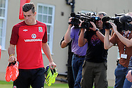 Gareth Bale arrives under the media spotlight for the Wales football team training session at the Vale , Hensol near Cardiff,  South Wales on Tuesday 3rd Sept 2013, the team are training ahead of their next FIFA World cup qualifier. pic by Andrew Orchard,  Andrew Orchard sports photography,