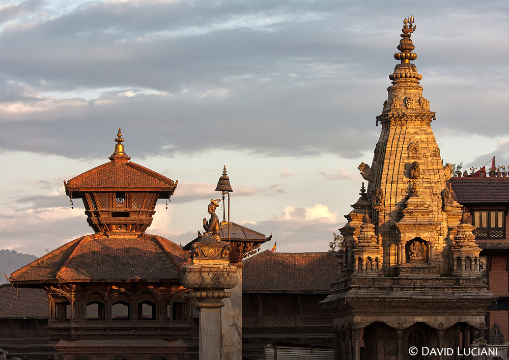 Sunset on Bhaktapur's Durbar Square with the octagonal Chyasilin Mandapam Temple on the left, the statue of King Bhupatindra Malla in the center and the Vatsala Durga Temple on the right.