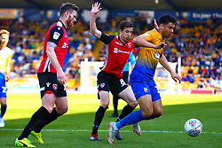 Tyler Walker of Mansfield Town falls after pressure from Mansfield Town players - Mandatory by-line: Ryan Crockett/JMP - 19/04/2019 - FOOTBALL - One Call Stadium - Mansfield, England - Mansfield Town v Morecambe - Sky Bet League Two