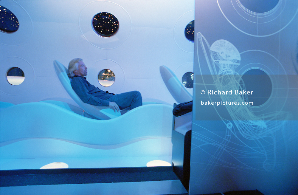 Virgin boss Sir Richard Branson sits in the replica model of the Virgin Galactic SpaceShipTwo during its unveiling of at the New York Wired NextFest at the Jacob K. Javits Convention Center. Under construction by Burt Rutan in Mojave, California and looking more like a Stanley Kubrick movie set from '2001 A Space Odyssey,' than the future for everyday holidays, SpaceShipTwo is a re-usable orbiting vehicle that will become an important tool for Man's leisure time in space when affordable commercial space tourism starts in around 2009. Aboard the re-usable space vehicle will be 6 passengers, each of whom paying $200,000 for the 40 minute flight to 360,000 feet (109.73km, or 68.18 miles) and to experience just 6 minutes of weighlessness. From these circular portholes, astronauts will see 1,000 miles having taken off from the new Spaceport America, New Mexico. ..