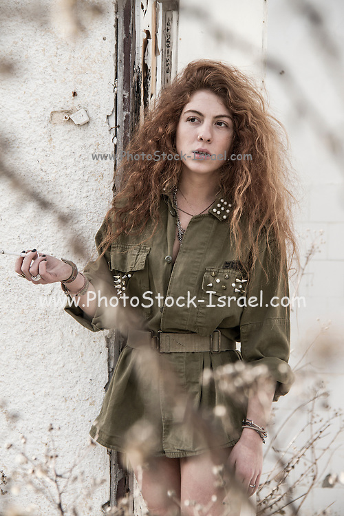 Military concept. Model in Israeli Army uniform is a deserted location