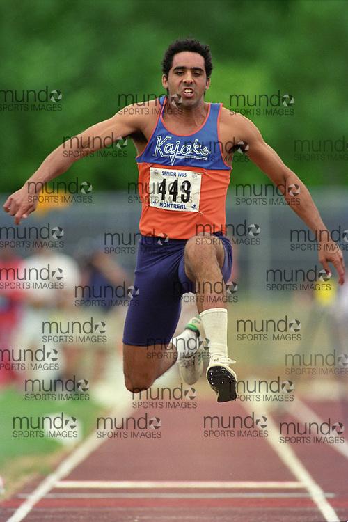 (Montreal, Canada---28 July 1995) Byron Jack jumps in the triple jump at the 1995 Canadian National Track and Field Championships. Photo 1995 Copyright Sean Burges / Mundo Sport Images.
