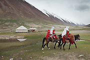 Ooroon Boi's family arriving to the summer camp during migration..Daily life at the Khan (chief) summer camp of Kara Jylga...Trekking through the high altitude plateau of the Little Pamir mountains (average 4200 meters) , where the Afghan Kyrgyz community live all year, on the borders of China, Tajikistan and Pakistan.