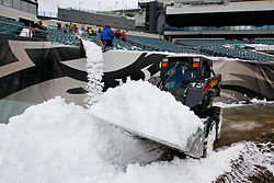 Workers remove snow from stands before the NFL game between the San Francisco 49ers and the Philadelphia Eagles on December 20th 2009.  At Lincoln Financial Field in Philadelphia, Pennsylvania. (Photo By Brian Garfinkel)