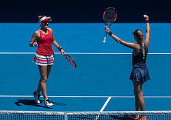 MELBOURNE, Jan. 24, 2018  Timea Babos (L) of Hungary and Kristina Mladenovic of France celebrate after the women's doubles semifinal against Peng Shuai of China and Hsieh Su-Wei of Chinese Taipei at Australian Open 2018 in Melbourne, Australia, Jan. 24, 2018. Timea Babos and Kristina Mladenovic won 2-0 to enter the final. (Credit Image: © Zhu Hongye/Xinhua via ZUMA Wire)