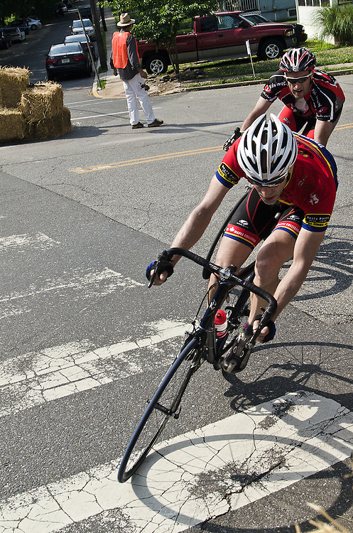 Rounding the corner of Laurel and Broadway during the first race of the Bob Riccio Memorial bicycle races in Pitman, NJ.