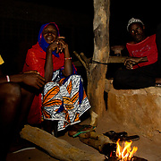 Winter evenings are spent around the fire for Koumbadiouma's chief and his close family. Kolda, Senegal.