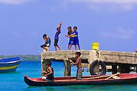 Kuna Indian boys fishing off a dock on Wichub Wala island, San Blas Islands (Kuna Yala), Caribbean Sea, Panama