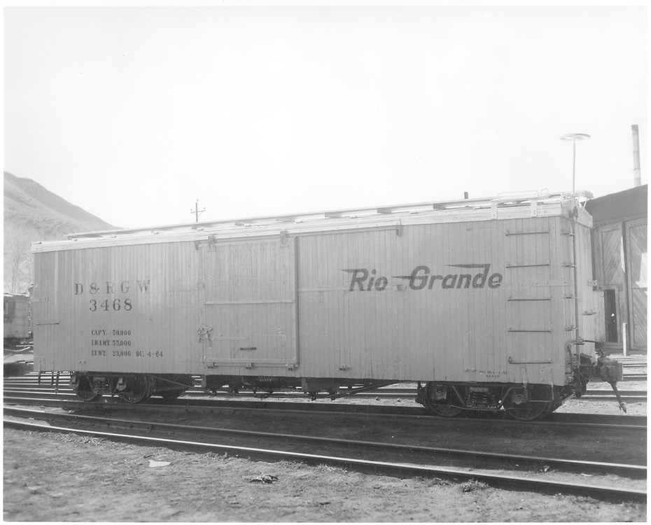 Side view of box car #3468 in yellow paint at Durango.<br /> D&RGW  Durango, CO  1964
