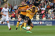 Aaron O'Connor of Newport county (c) shoots and scores his side's fourth goal. Skybet football league two match, Newport county v AFC Wimbledon at Rodney Parade in Newport, South Wales on Saturday 27th Sept 2014<br /> pic by Mark Hawkins, Andrew Orchard sports photography.