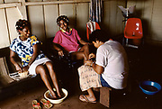 Brazil - Pará State - Serra Pelada - Women attend to their hair and nails in a beauty salon in a rural setting.