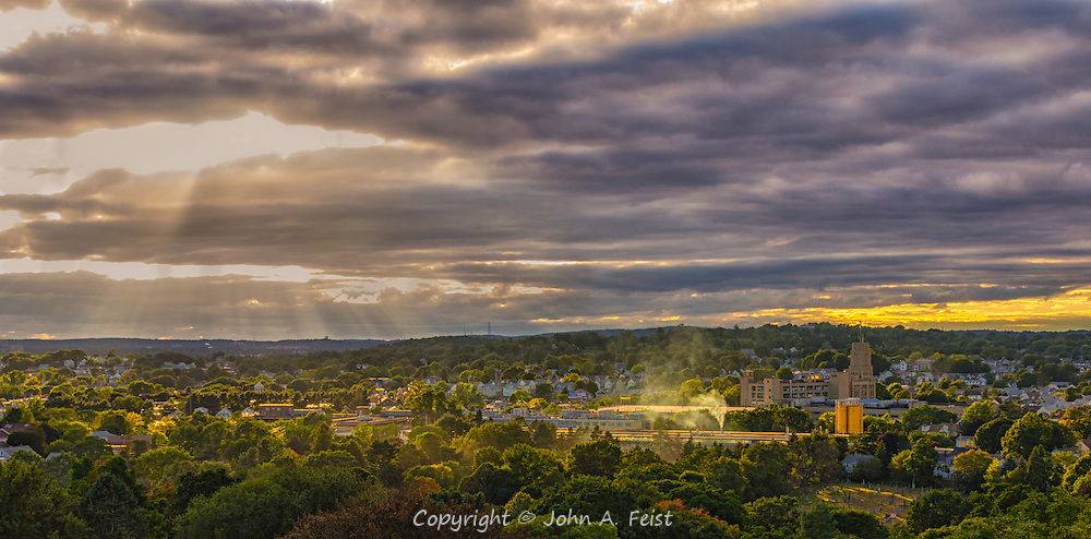 Looking north from the Washington Tower at Mount Auburn Cemetery in Watertown, MA.  While visiting our daughter, we decided to tour this very interesting and historic cemetery.  The tower is one of the highest points around offering incredible unobstructed views. <br /> <br /> This shot is all about the clouds, the sun rays and the many and varying points of light and color being created