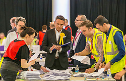 The counting of votes in the European Parliamentary Election for the City of Edinburgh counting area takes place at EICC, Morrison Street, Edinburgh. <br /> <br /> Pictured: MSP Alex Cole-Hamilton watching the vote