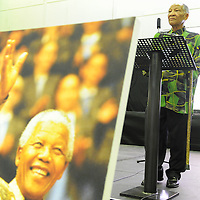 KHAYELITSHA, SOUTH AFRICA - Monday 9 December 2013, the City of Cape Town hosted an Evening of Remembrance at the OR Tambo hall, Khayelitsha. for the late former President of South Africa, Nelson Mandela. Dr Don Mattera reads his poems to the audience.<br /> Photo by Roger Sedres/ImageSA