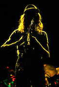 John Halliwell of Supertramp in silhouette with yellow light