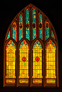 Stained glass windows at night at Wai'oli Hui'ia Church, Hanalei, Island of Kauai, Hawaii USA
