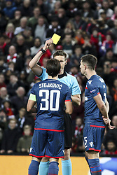 October 24, 2018 - Liverpool, United Kingdom - Crvena Zvezda defender Filip Stojkovic (30) is shown a yellow card by the referee Daniel Siebert during the Uefa Champions League Group Stage football match n.3  Liverpool v FK Crvena Zvezda on October 24, 2018, at the Anfield Road in Liverpool, England. (Credit Image: © Matteo Bottanelli/NurPhoto via ZUMA Press)