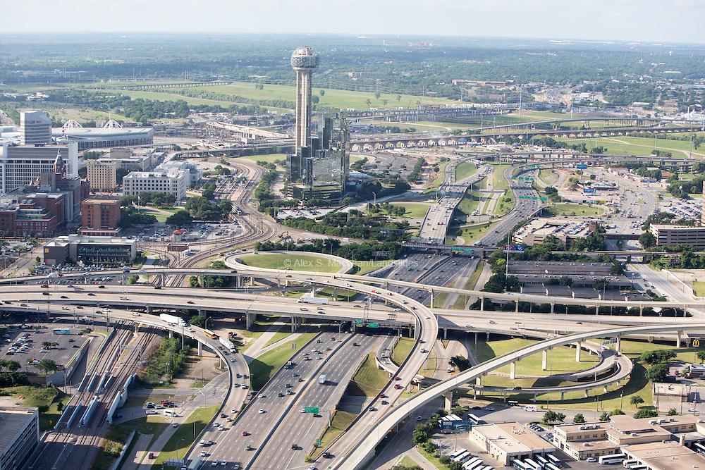 Interchanges on the edge of Downtown Dallas. Reunion tower of Hyatt Regency Dallas.