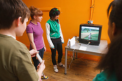 Teenagers on Wii game in Youth Club. Cleared for Mental Health Issues.