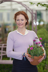 "© Licensed to London News Pictures. 21/05/2012. London, England. The actress Geraldine Somerville launches new plant Osteospermum ""In The Pink"" at Hardy's Cottage Garden Plants.  RHS Celsea Flower Show 2012 - Press Day. Photo credit: Bettina Strenske/LNP"