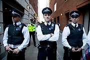 "Police lines blocking Paternoster Square. Occupy London protest, October 15th 2011. Protest spreads from the US with this demonstrations in London and other cities worldwide. The 'Occupy' movement is spreading via social media. After four weeks of focus on the Wall Street protest, the campaign against the global banking industry started in the UK this weekend, with the biggest event aiming to ""occupy"" the London Stock Exchange. The protests have been organised on social media pages that between them have picked up more than 15,000 followers. Campaigners gathered outside  at midday before marching the short distance to Paternoster Square, home of the Stock Exchange and other banks.It is one of a series of events planned around the UK as part of a global day of action, with 800-plus protests promised so far worldwide.Paternoster Square is a private development, giving police more powers to not allow protesters or activists inside."