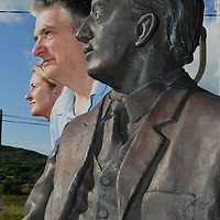 12-7-2018:  Heroes of the arts and music to be celebrated in Gaeltacht festival..<br /> Pictured 'looking ahead' to Féile na Laoch (Festival of Heroes) 2018 are Peadar Ó Riada and Treasa Ní Riordáin of Féile na Laoch's organising meitheal at the statue of Seán Ó Riada in the churchyard of Séipéal Chúil Aodha in North Cork. Heroes from the spheres of music, song, drama, poetry, dance and the visual arts will participate in one of the most unique festivals on the island during the five day festival which ends on 1 August, the birthday of composer Seán Ó Riada, who died at the age of 40 in 1971.  The festival has been devised by composer and musician Peadar Ó Riada as a tribute to his late father and as a wake up call to modern society to alert us to the necessity of taking time out to evaluate where we are and to use our heroes as inspirations to set new goals for the next seven years. <br /> Photo: Don MacMonagle<br /> <br /> pr photo photo<br /><br />Press Release:<br />Preparations are stepping up in the Múscraí village of Cúil Aodha as the Gaeltacht community anticipates the arrival of the seven yearly gathering of heroes for Féile na Laoch - the Festival of Heroes. <br />Heroes from the spheres of music, song, drama, poetry, dance and the visual arts will participate in one of the most unique festivals on the island during the five day festival which ends on 1 August, the birthday of composer Seán Ó Riada, who died at the age of 40 in 1971.  The festival has been devised by composer and musician Peadar Ó Riada as a tribute to his late father and as a wake up call to modern society to alert us to the necessity of taking time out to evaluate where we are and to use our heroes as inspirations to set new goals for the next seven years. <br />President Michael D.Higgins, wearing his poet's hat, will be the chief of seven poets which include Nuala Rua NÍ Dhomhnaill, Dairena Ní Chinnéide and Betsy Ní Shuibhne, the president of the bardic school, Dámh Scoil Mhúscraí.  Th