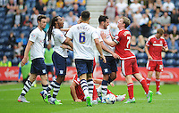 Middlesbrough's Grant Leadbitter reacts angrily to a challenge, pushing Preston North End's Greg Cunningham<br /> <br /> Photographer Kevin Barnes/CameraSport<br /> <br /> Football - The Football League Sky Bet Championship - Preston North End v Middlesbrough -  Sunday 9th August 2015 - Deepdale - Preston<br /> <br /> © CameraSport - 43 Linden Ave. Countesthorpe. Leicester. England. LE8 5PG - Tel: +44 (0) 116 277 4147 - admin@camerasport.com - www.camerasport.com