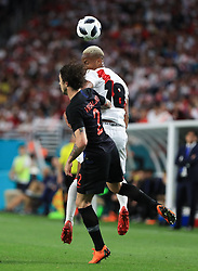 March 23, 2018 - Miami Gardens, Florida, USA - Peru forward Andre Carrillo (18) out jumps Croatia defender Sime Vrsaljko (2) to head the ball during a FIFA World Cup 2018 preparation match between the Peru National Soccer Team and the Croatia National Soccer Team at the Hard Rock Stadium in Miami Gardens, Florida. (Credit Image: © Mario Houben via ZUMA Wire)