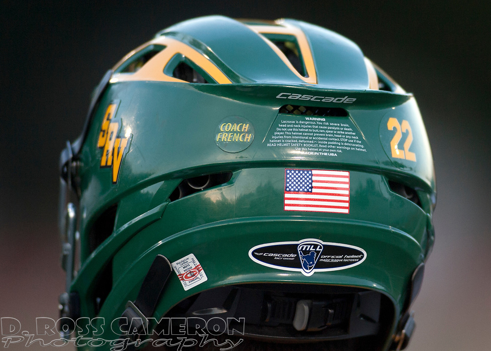 A sticker memorializing assistant coach Todd French, who died in January, adorns the helmets of San Ramon Valley High School boys' lacrosse team members; photographed Wednesday, May 6, 2015 in Danville, Calif. (D. Ross Cameron/Bay Area News Group)