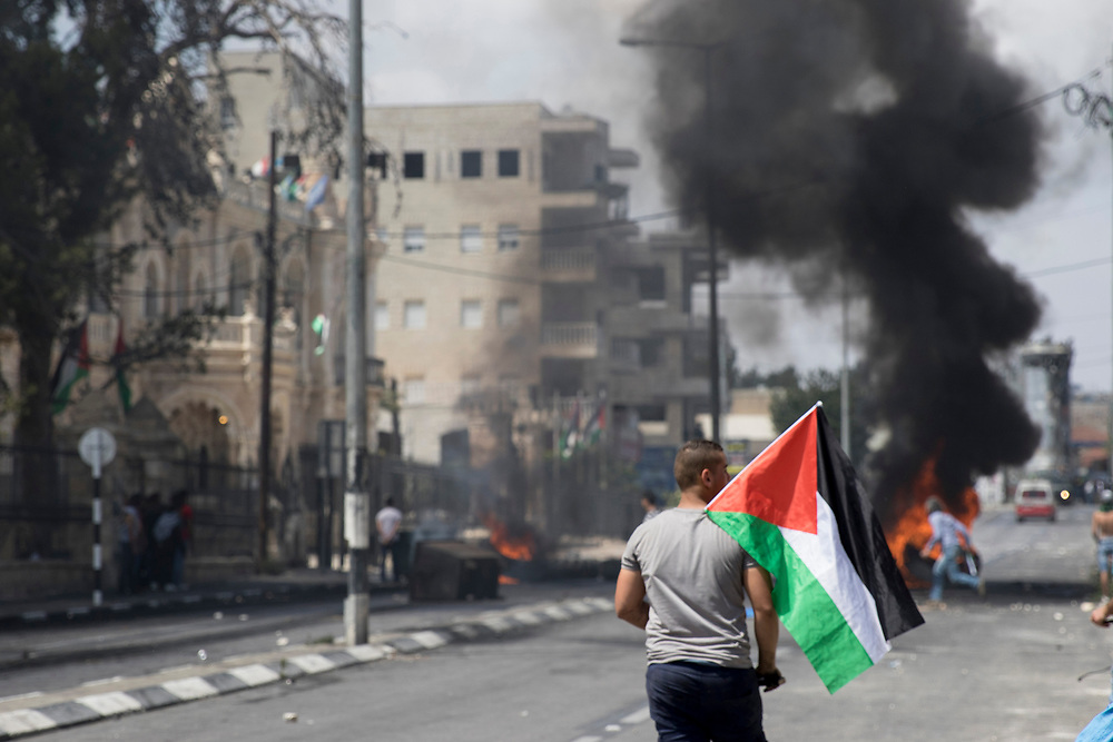 Bethlehem, Palestine. 15 May 2018. Protesters clash with Israeli soldiers on the 70th anniversary of the Nakba (Catastrophe) when over 700,000 Palestinians were forcibly moved from their homes during the creation of Israel. © Craig Redmond