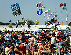 03 May 2015. New Orleans, Louisiana.<br /> The New Orleans Jazz and Heritage Festival. <br /> Flags flutter in the breeze amongst the crowd at the Acura stage. <br /> Photo; Charlie Varley/varleypix.com