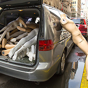 Mannequins are seen in a moving van on the street in New York City on Monday, September 28, 2015.  (Alex Menendez via AP)