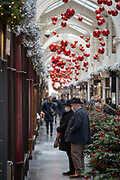 As England finishes its second Coronavirus pandemic lockdown, and London enters a Tier 2 restriction, Londoners window shop in Burlington's Arcade as they return to the West End to start their Christmas high street shopping, on 2nd December 2020, in London, England.
